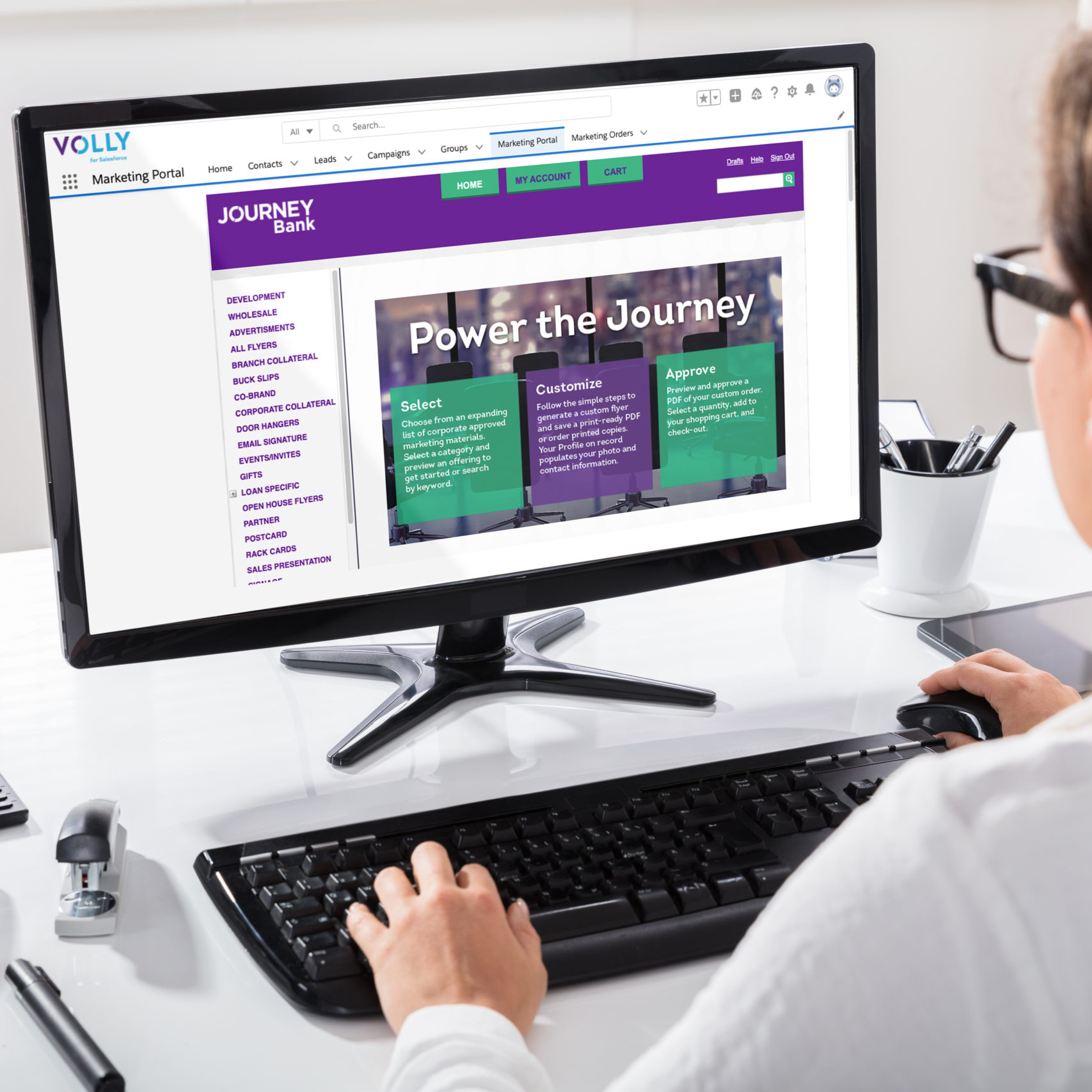 An employee using Volly for Salesforce solution on her computer.