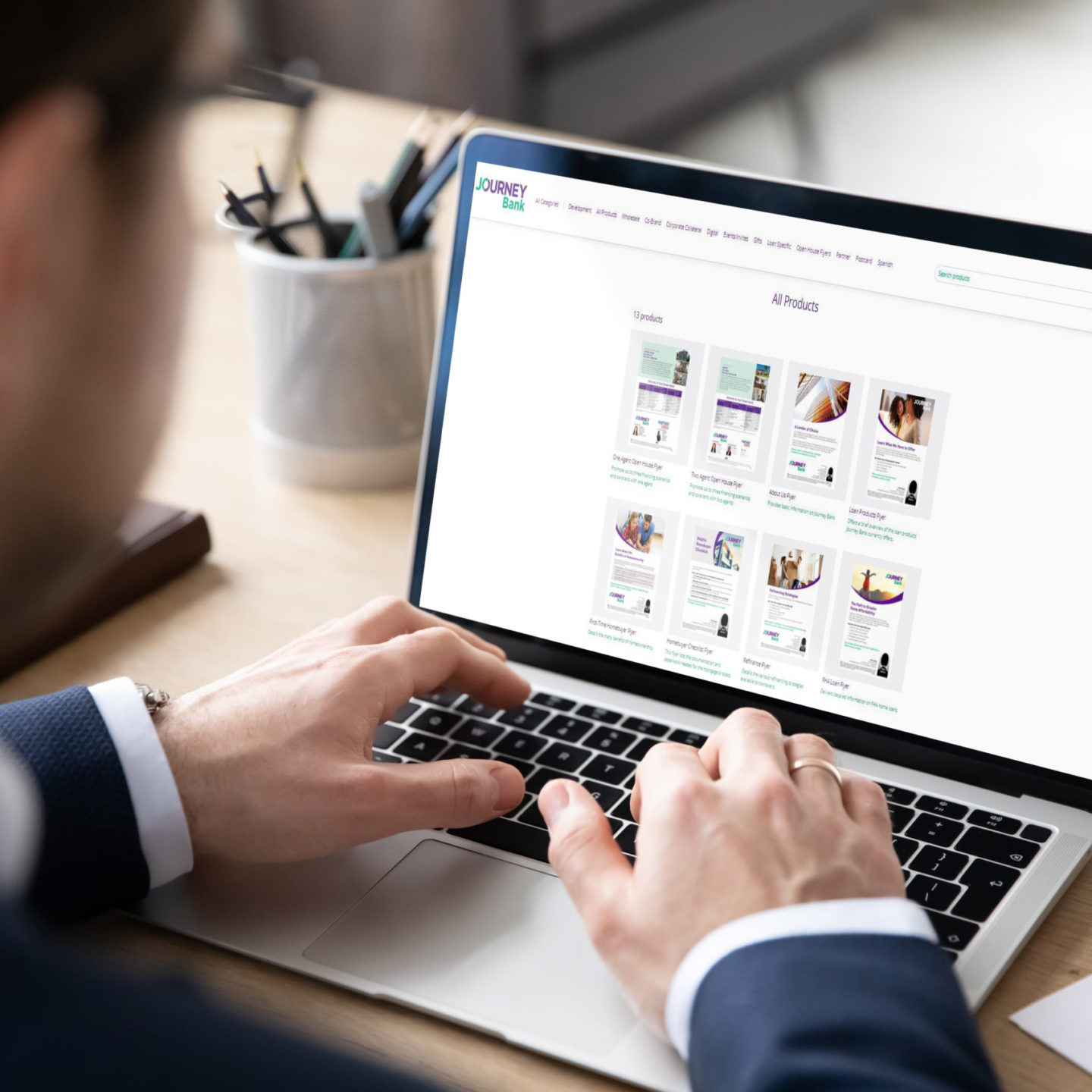 An employee using the Volly Marketing Portal Software